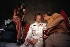 Jochen Rindt in pits with wife Nina and Lotus team boss Colin Chapman. Championship: Formula 1 1970 Event: Austrian GP Date taken: Sunday, August 1970 Location: Red Bull Ring, Austria Photographer: Rainer Schlegelmilch Bugatti Royale, Red Bull, Bitchy Resting Face, Austrian Grand Prix, Jochen Rindt, Mod Look, Ford, F1 Drivers, Green Hats