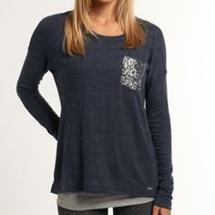 """Superdry Navy Blue Sequin Pocket Long Sleeve Tee SUPERDRY Shimmer Luxe long sleeve t-shirt in The color is called Eclipse Navy; it's a deep heathered blue. Size small. Worn twice. Classic crew neck. Soft, drapey cotton/poly blend. Sequin pocket. Back seam w/ stitch detailing. Lots of stretch. ~21"""" across from underarm to underarm, and ~25"""" long from back collar to bottom hem, lying flat. No flaws. A few pills under the arms which can be shaved off (typical for cotton, even after 1–2 wears.)…"""
