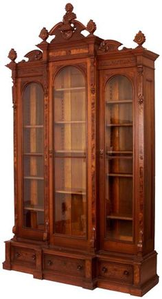 Breakfront Example: Victorian Renaissance Revival triple door breakfront bookcase with Shakespeare bust, American, 1860-1880.