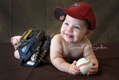 baby boy - baseball themed photo. could be a cute idea (ice hockey, basketball, etc.)