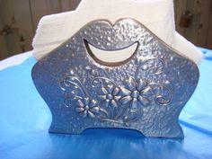 servilletero repujado en aluminio