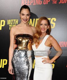Actresses Gal Gadot and Isla Fisher attend the premiere of 'Keeping Up with the Joneses' at Fox Studios on October 8, 2016 in Los Angeles, California.