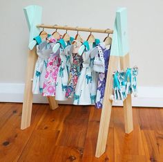 The sweetest little doll's clothing rack! This little one has a hanging height of 30cm. To give you an idea of size, the dresses hanging in the picture are 18cm long. The rack also comes with 5 wooden hangers. Dipped ends on the rack and hangers are painted in colours of your choice, please specify in the notes section at checkout.You can also choose between crystal or wooden hanging knobs (perfect for hanging little purses and accessories).Please allow two weeks bef...