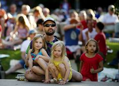 Lee Hanson (middle) holds his daughters  Ada (left), 5, and Elsy, 3, while listening to jazz band Tizer during the first Jazz n' June of the summer on Tuesday, June 5, 2012 at the Sheldon Sculpture Garden in Lincoln.