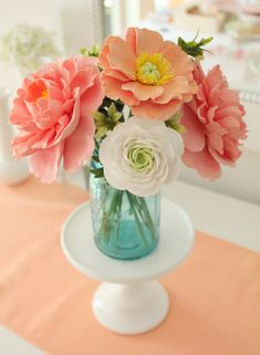 Wedding inspiration colors, or flowers displayed on a cake stand, love the idea.