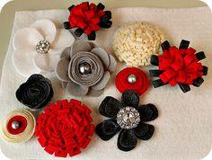 Flores de fieltro rojo, negro, blanco y beig