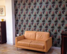 This wallpaper brings Africa to England in this lovely home. Fabric Wallpaper, Pattern Wallpaper, Wall Patterns, Surface Pattern Design, Living Area, Aloe, Fabrics, Wallpapers, Curtains