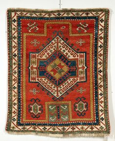 Fachralo Kazak Prayer Rug, Southwest Caucasus, last quarter 19th century, (even wear to center, several small spots of repiling, minor end fraying), 4 ft. 10 in. x 3 ft. 10 in.