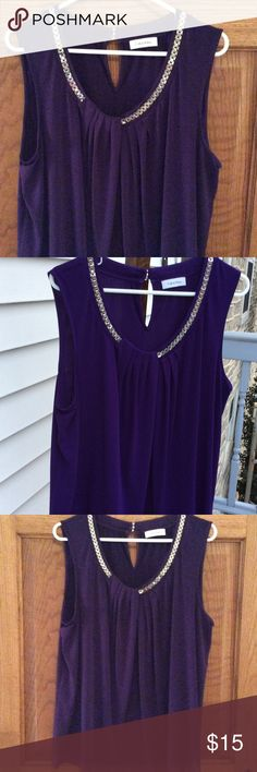 Purple sleepless blouse Calvin Klein purple sleeveless blouse. Silver chain detail at neckline. Pleated front. Keyhole at back neckline. Double layer hem with sheer underlay. Excellent condition Calvin Klein Tops Blouses