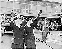 Photograph of First Lady Bess Truman and Margaret Truman waving goodbye to the President as he leaves Washington National Airport on a trip home to Independence, Missouri., 11/04/1950