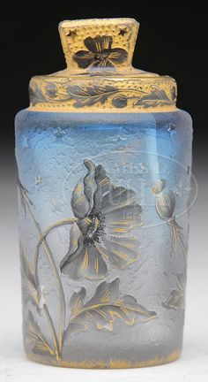 James D. Julia, Inc. -  Daum Nancy Scent jar. The beautiful jar, with Oriental poppies in various stages of bloom, surround this textured blue to frosted jar. Poppies are highlighted with gilding, as is the rim and lid.