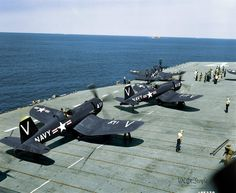 F4U-4s taxi into position for launch aboard the USS Philippine Sea, Korea, 1951 . . .
