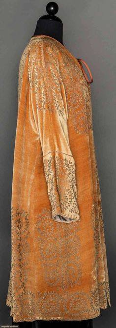 FORTUNY STENCILED VELVET COAT, c. 1930  Apricot velvet w/ gold stenciled botanicals, long sleeves, silk cord & tie at neck, gray silk charmuese lining
