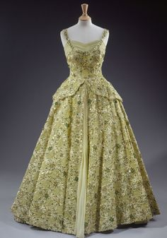In 1957 when the Queen needed to wow the American people on her first visit to the US as monarch, she turned to Sir Norman Hartnell, the man who designed her wedding and coronation robes. The result was this stunning pale green crinoline evening dress, hand-embroidered with sequins, pearls, beads & diamante.