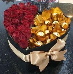 An arrangement of roses, and golden Ferrero Rocher chocolates