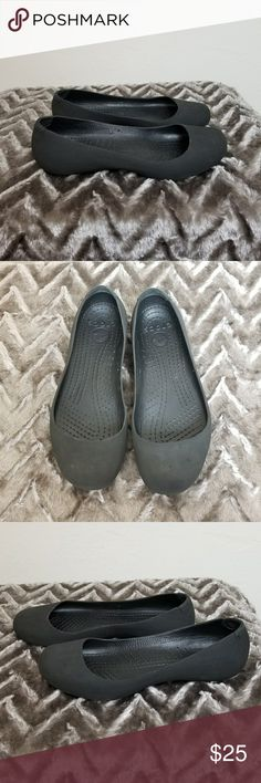 Women's Crocs Flats Black flats, super comfortable. These are great for anyone on their feet a lot. They give a lot more support than your average flats. They have a couple spots on the toes, and writing on the bottom, other than that they are in great condition. Size 8 CROCS Shoes Flats & Loafers