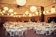 reception in a gym. paper lanterns for lighting.