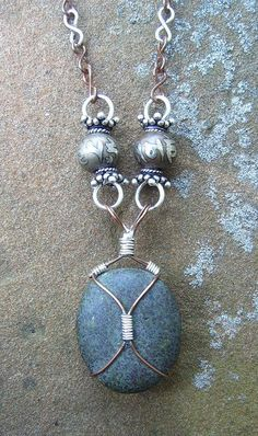 Simple bead caging...this would be great with one of my lake stones from the UP