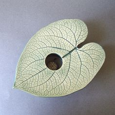 heart leaf handmade pottery vase. $30.00, via Etsy. I have made some Ikebana style vases very similar to this one.