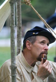 George Taggart smokes a pipe in the Union camp following a commemorative ceremony for the 150th anniversary of the Battle of Williamsburg on Saturday, May 5. (Kaitlin McKeown / May 5, 2012)