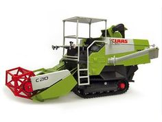 This Claas Crop Tiger 30 Diecast Harvester Model is Green and features working cutters, tracks and also opening bonnet with engine. It is made by Universal Hobbies and is 1:32 scale (approx. 15cm / 5.9in long).  ...