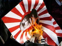 Slideshow : Violent protests heat up Japan - Violent protests heat up Japan | The Economic Times