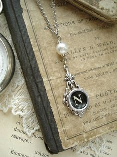 Typewriter Key Jewelry - Black Letter N Necklace. Vintage Typewriter Key Necklace. Antique Silver with White Glass Pearl. Monogram Necklace.. $39.50, via Etsy.