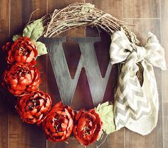 Monogrammed Red Flowery Grapevine Wreath with a Chevron Burlap Bow.