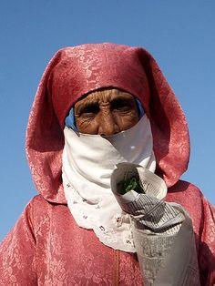 ...Elder buying mint at market in Essouira, Morocco...