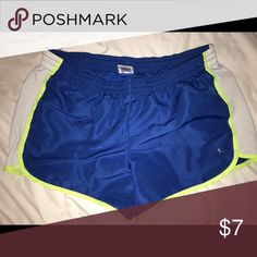Athletic Shorts Blue, white, highlight green. Size LG, but fits more like a medium. They've NEVER been worn! Shorts