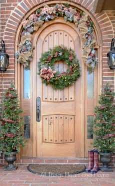 "<p>Burlap and plaid are clearly a pretty combination — especially when woven throughout an evergreen wreath. </p><p><a href=""http://www.allthingsheartandhome.com/2014/12/welcome-home-christmas-tour-2/"">See more at All Things Heart & Home »</a> </p>"