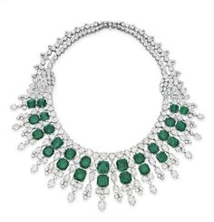 AN EMERALD AND DIAMOND NECKLACE, BY HARRY WINSTON.   Designed as a graduated double row of rectangular-cut emeralds, extending a pear and circular-cut diamond fringe, joined by circular and pear-shaped diamond clusters to the circular-cut diamond double row backchain, mounted in platinum, 1955, 14 ins.  With maker's mark for Harry Winston
