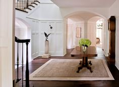 Beautiful arches and panelling.  White and dark stained wood. Stunning work by Donald Lococo Architects, McLean, VA