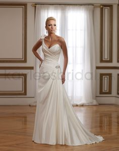 Satin Sweetheart Hand-Draped Bodice A-line Wedding Dress  This is what I want...without the pointy part and the tacky bow in the back.
