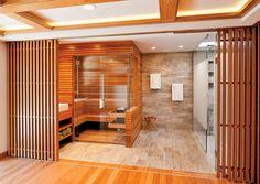 Amenities abound in this envy-worthy home spa, which boasts a sauna, a steam room, and a generous shower. Home Steam Room, Modern Saunas, Private Sauna, Green House Design, Sauna Design, Home Gym Decor, Sauna Room, Basement Sauna, Bathroom Spa