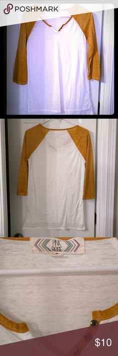 """Casual Long Sleeve T-Shirt Sporty rustic orange and white 3/4"""" sleeve casual t-shirt. It's got three little copper colored buttons on one side of the v neck. It's got short slits on both sides at the bottom and is longer in back. Comes in handy paired with low riding jeans.  Fabric is fairly thin so it's a lightweight shirt. Wear over a tank with jeans and a scarf for a cute look while it's chilly. Pink Rose Tops Tees - Long Sleeve"""