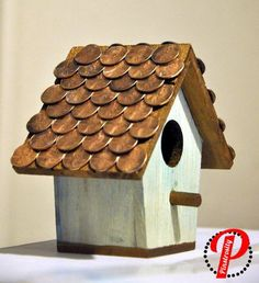 Penny Birdhouse. Enjoy watching birds outside of your kitchen window with this amazing DIY penny birdhouse. See how to do it
