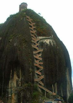 Now that's a set of stairs. 659 stairs to the top, The Guatape Rock in Colombia. I've climbed the Santa Monica Stairs MANY some stairs.this looks AWESOME! Places Around The World, Oh The Places You'll Go, Places To Travel, Places To Visit, Around The Worlds, Travel Destinations, Wonderful Places, Beautiful Places, Amazing Places