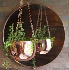 Hang a few small cooper vases from the ceiling in the recessed corner of the angled wall