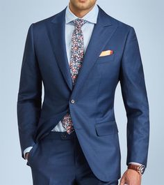 The Dark orange floral tie and Wedgwood cutaway shirt under a navy suit and Orange leaf silk pocket square. #Grandfrank  www.Grandfrank.com