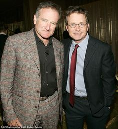 Robin Williams with actor Michael J Fox, who was just 29 years old when he was diagnosed with Parkinson's