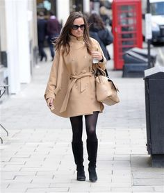 Pippa steps out in camel-color coat, black opaque tights and knee-high boots. See more celebs on Wonderwall: http://on-msn.com/WHWiwp