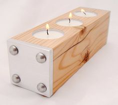 Pretty sleek candle holder with some thought put into it!:) Like handmade candle holders:)