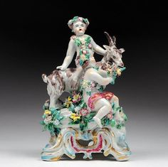 18th century Bow porcelain figurine children frolicked with her goat, usually laden with flower inlay and set on the basis of the Rococo.