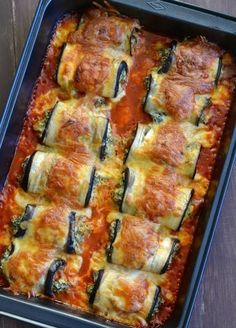 INGREDIENTS 4  eggplants 1/4 cup olive oil 1 package frozen spinach, thawed 3 cups ricotta cheese 1 egg 1 1/2 cups prepared marinara sauce 2 cups parmesan cheese, grated, divided 3/4 cups fresh bas…