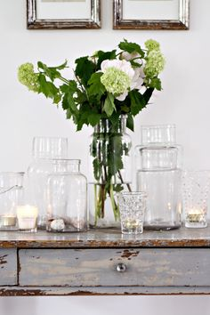 glass jars with candles and flowers via Décor de Provence