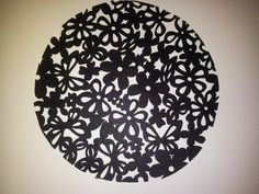An easy artwork to make from a couple of cut-out place mats.  I used two rectangular ones and put them together, then cut out a large circle shape.  Very effective, don't you think?