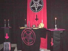 satanic altar with pentagram and upside down crosses. why would these same symbols be in some churches? you decide.