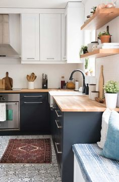 Learn how to paint kitchen cabinets like a pro with this easy tutorial, BEHR Paint in Ultra Pure White and Night Club. open shelving, butcher block countertops, a patterned tile floor, and a bright white tile backsplash Paint Kitchen Cabinets Like A Pro, Painting Laminate Cabinets, Two Tone Kitchen Cabinets, Kitchen Redo, Laminate Cabinet Makeover, Butcher Block Countertops Kitchen, Diy Countertops, White Cabinets, Wood Cabinets