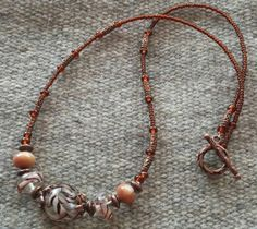 Brown Marble Swirl Bead Necklace  Glass Beads by goosecrossingfarm, $28.00  https://www.etsy.com/listing/181338695/brown-marble-swirl-bead-necklace-glass?